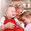 Happy children with granny - Stock Photo