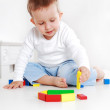Lovely boy playing with blocks — Stock Photo