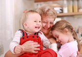 Happy children with granny — Stock Photo