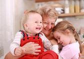 Happy children with granny — Stock Photo