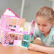 Playing with doll's house — Stock Photo #2972950