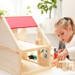Playing with doll's house - Stock Photo