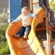 Kid at playground - Stock Photo