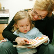 Reading with mom - Stock Photo