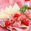 Sliced ham on plate in red tone - Stock Photo