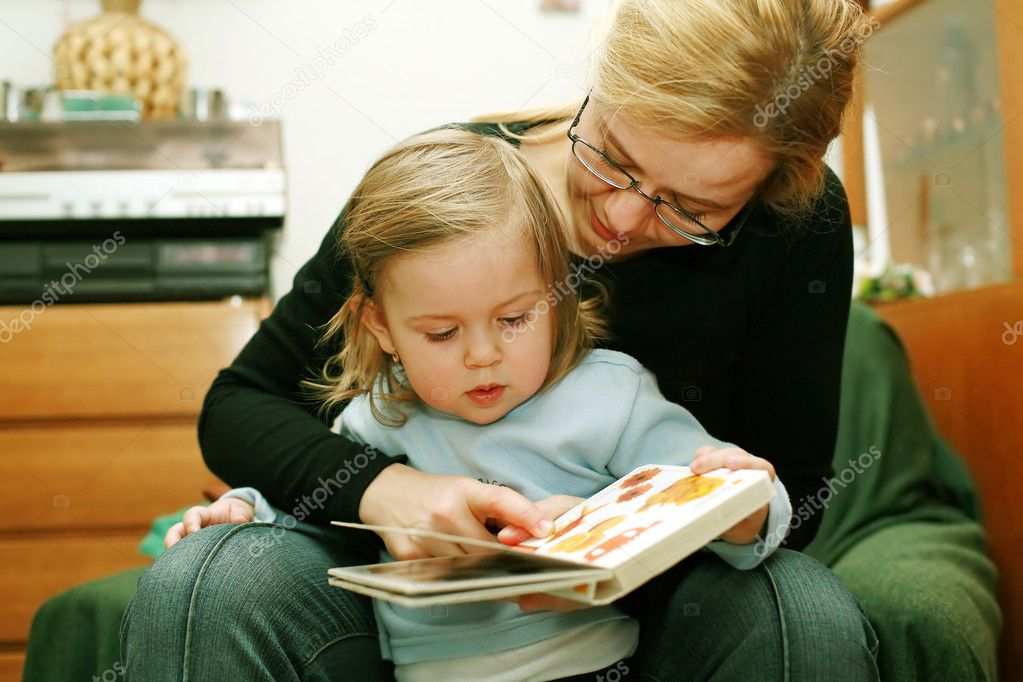 Cute little girl looking at picture  Stock Photo #3170068