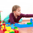 Adorable girl playing with blocks — Stock Photo #3218502