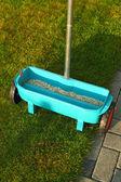 Gardening - fertilizing lawn — Stock Photo