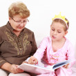 Reading with granny — Stockfoto