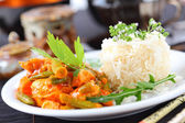 Red chicken curry stripes with rice — Stock Photo