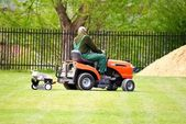 Caretaker mowing a soccer field — Stock Photo