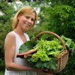 Stock Photo: Young woman holding vegetable