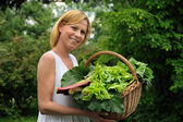 Young woman holding vegetable — Stock Photo