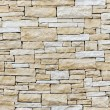 Wall made from sandstone bricks - Stock Photo