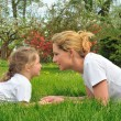 Young mother and daughter playing — Stock Photo
