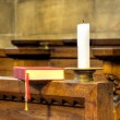 Stock Photo: Detail of hymnal and candle