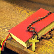 Stock Photo: Hymnal book and wooden rosary bead