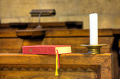 Detail of hymnal and candle — Stock Photo