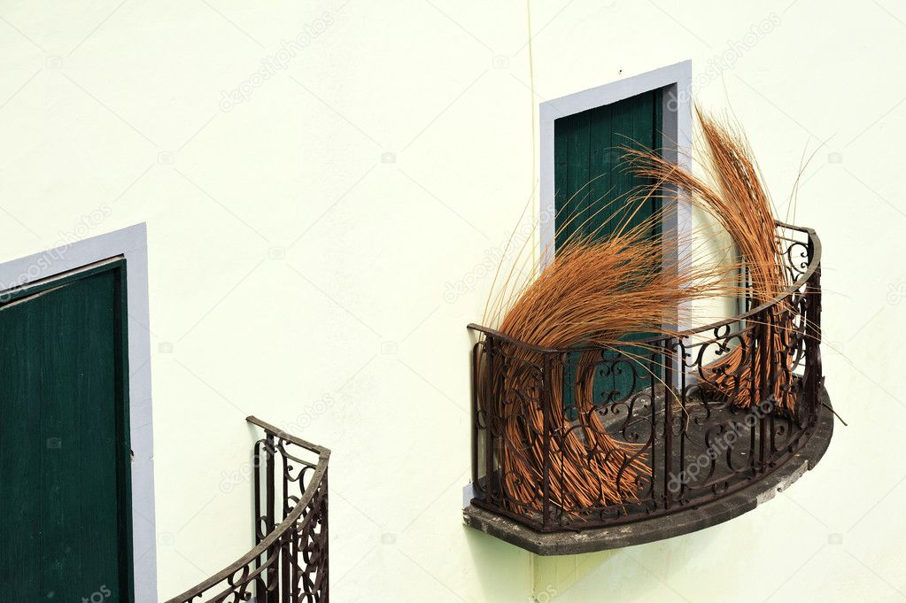 Balcony at old house in Madeira with package of wicker  Stok fotoraf #3351412