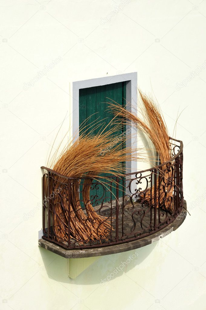 Balcony at old house in Madeira with package of wicker — Stock Photo #3522360