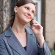 Young business woman with cell phone - Stock Photo