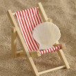 Deckchair at sunny beach — Stock Photo