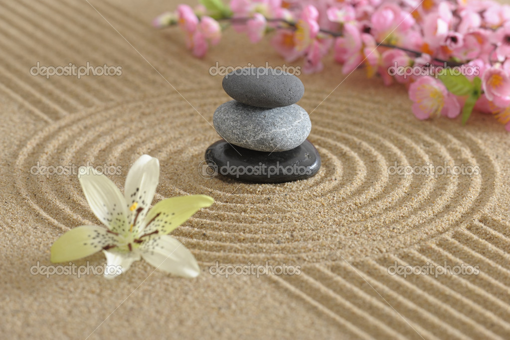 Zen garden in sand with flowers  Stock Photo #3286255