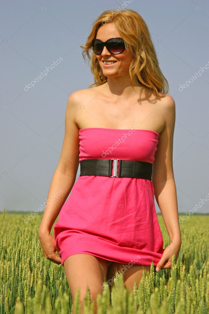 Beautiful sexy girl in a wheat field  Stock Photo #3313508