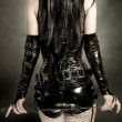Woman in black latex corset - Stock Photo