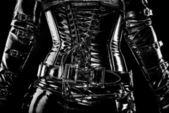 Black latex corset — Stock Photo