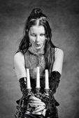 Gothic girl with candles — Stock Photo