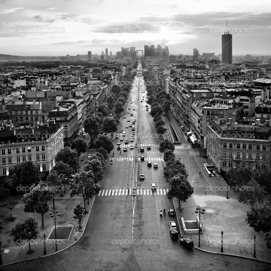 Av. de la Grande Armee, Paris, France. View from the top of the Arc de Triomphe; sunset. — Stock Photo #2850888