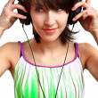 DJ girl with headphones smiling — Stock Photo