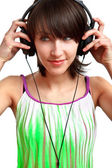 DJ girl with headphones smiling — Photo