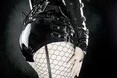 Woman in black latex uniform — Stock Photo