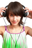 Girl with headphones — 图库照片