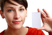 Girl holding an empty card — Stock Photo