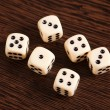 Royalty-Free Stock Photo: Dice on wooden table