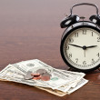 Alarm clock and money — Stock Photo #2813266