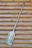 Old wooden baker's shovel on wall — Stockfoto