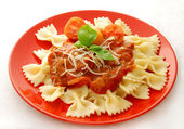 Farfalle with tomato sauce — Stock Photo