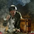 Man in military style in cigar smoke — Stock Photo