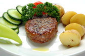 Burger with potatoes on plate — Stock Photo