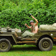 Man driving military jeep - Stock Photo