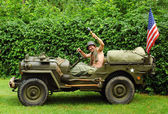 Man driving military jeep — Stock Photo