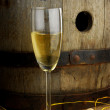 Glass of white wine and cask — Stock Photo