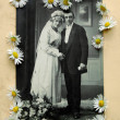 Royalty-Free Stock Photo: Vintage bridal pair with daisies
