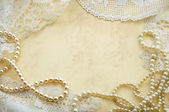 Background with pearls and doilies — Stock Photo
