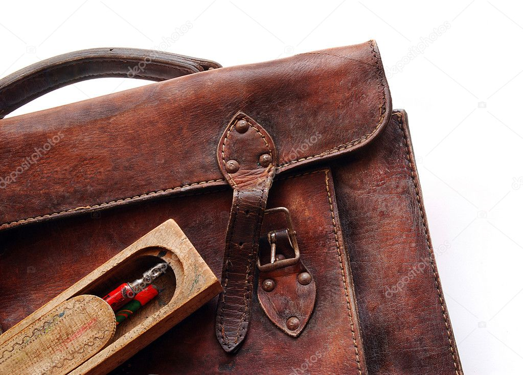 Old schoolbag with wooden pencase on white background  Stock Photo #2791474