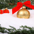 Foto Stock: Bauble with gift box